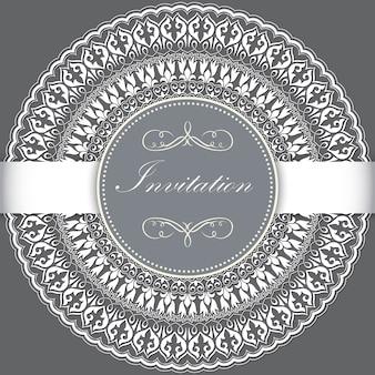 Invitación de boda y tarjeta de invitación con encaje redondo ornamental con elementos arabescos.