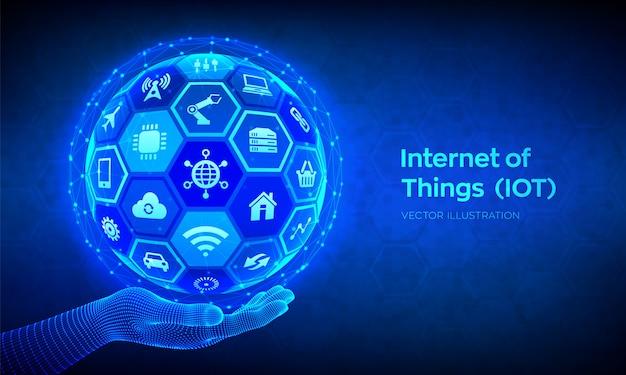 Iot internet de las cosas concepto. esfera 3d abstracto o globo con superficie de hexágonos en mano de estructura metálica.