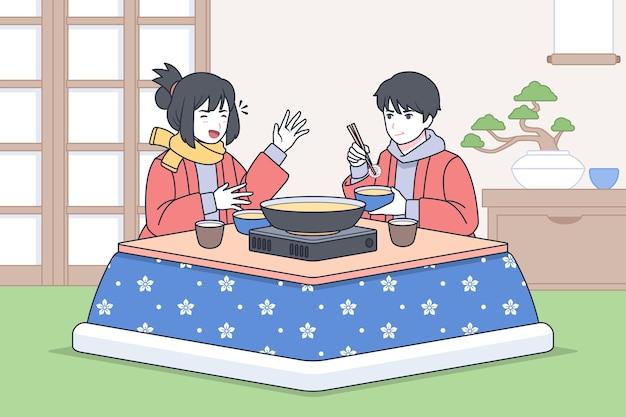 Japonés hablando y comiendo en la mesa
