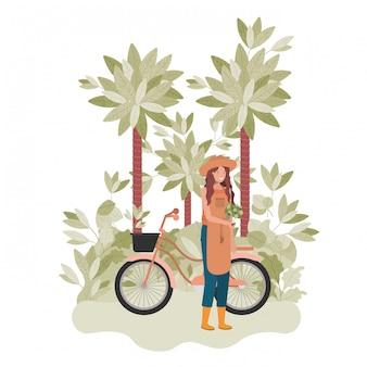 Jardinero mujer con árboles y bicicleta
