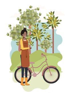 Jardinero mujer con paisaje y bicicleta