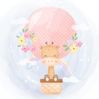 Jirafa y globo de aire