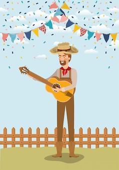 Joven agricultor tocando la guitarra con guirnaldas y cerca
