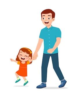 Joven apuesto padre cogidos de la mano y caminar con niños