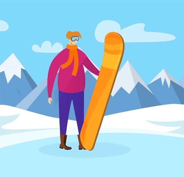 Joven deportista con snowboard en manos posando