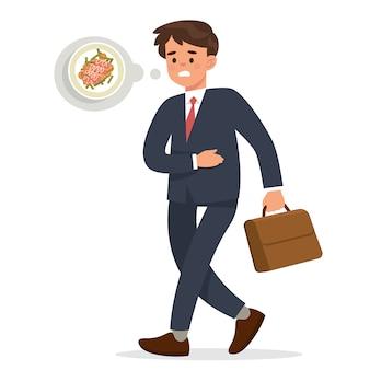 Joven empresario camina sosteniendo su estómago hambriento