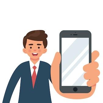 Joven empresario mostrar un teléfono en blanco
