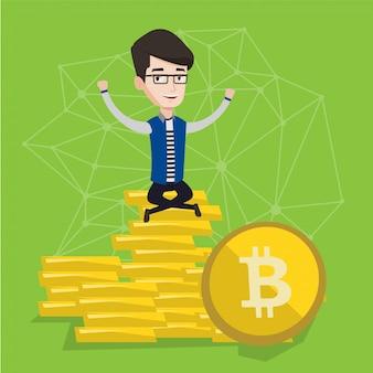Joven empresario sentado en monedas de oro bitcoin.