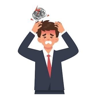 Joven empresario sostiene la cabeza por dolor de cabeza o sobrecarga