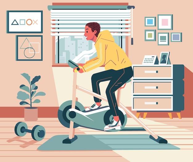 Joven haciendo ejercicio de rutina en casa con bicicleta estática con interior de diseño de apartamento