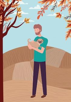 Joven con linda mascota perro en el campamento de otoño