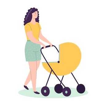 Una joven madre camina con un cochecito de bebé.