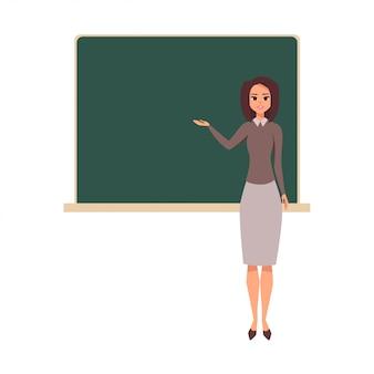 Joven maestra en la lección en la pizarra en el aula