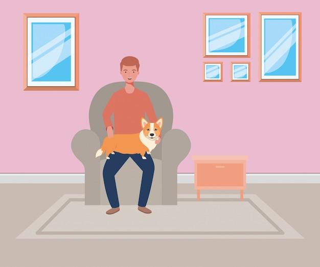 Joven con mascota perro lindo en la sala de estar
