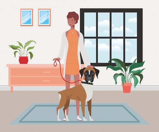 Joven mujer afro con lindo perro interior de casa