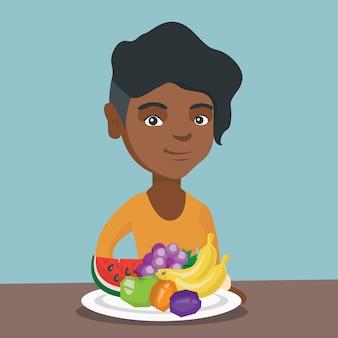 Joven mujer afroamericana con frutas frescas.