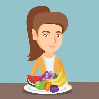 Joven mujer caucásica con frutas frescas.