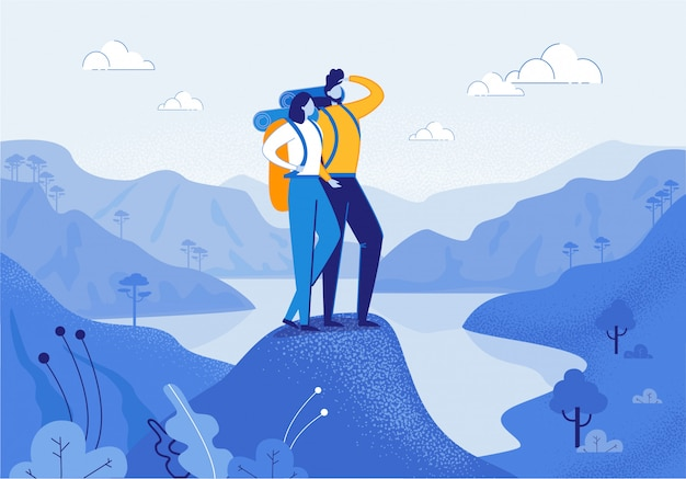 Joven mujer y hombre pareja senderismo en las montañas