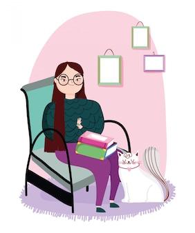 Joven mujer sentada con libros en piernas y gato, día del libro