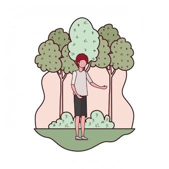 Joven en paisaje con árboles y plantas