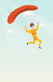 Joven paracaidista caucásico volando con un paracaídas