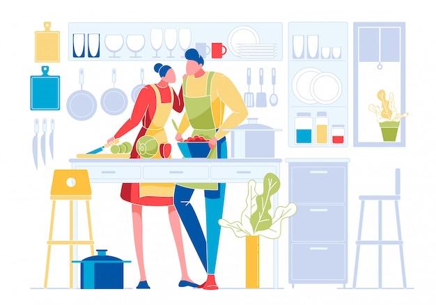 Joven pareja amorosa cocinando juntos en la cocina