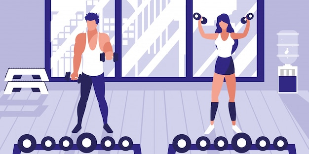 Joven pareja atlética levantando pesas en el gimnasio