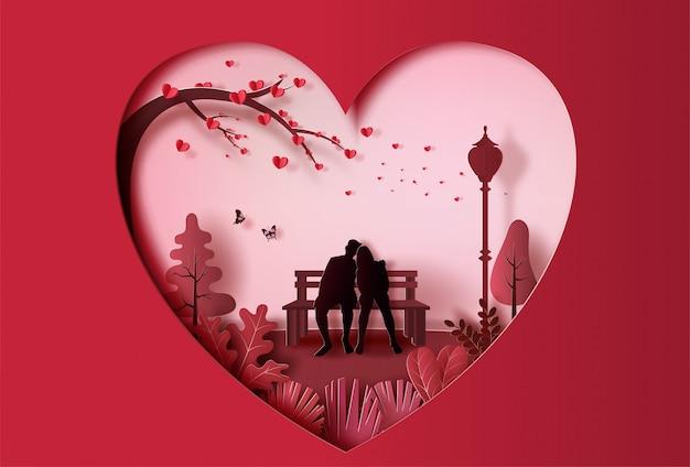 Joven pareja de enamorados sentados en un banco en el parque, estilo de arte de papel.