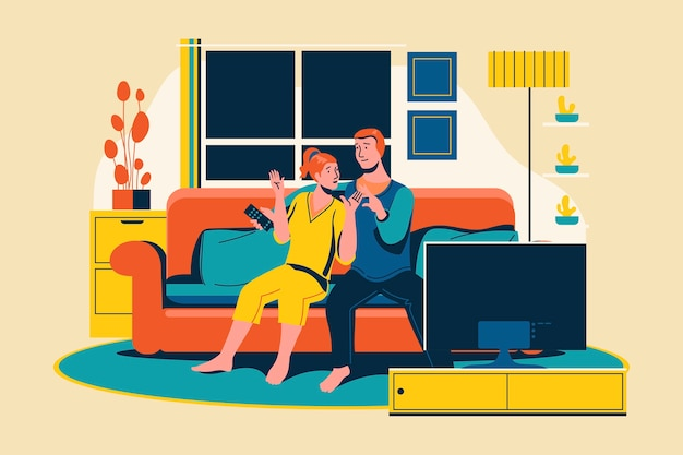 Una joven pareja relajarse viendo la televisión en la sala de estar