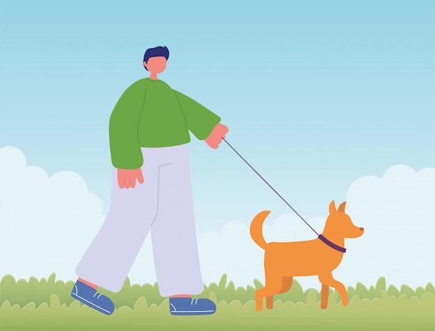 Joven con perro caminando