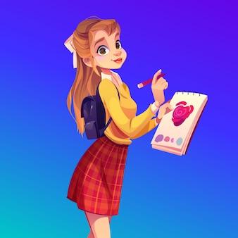 Joven pintora con cuaderno y lápiz