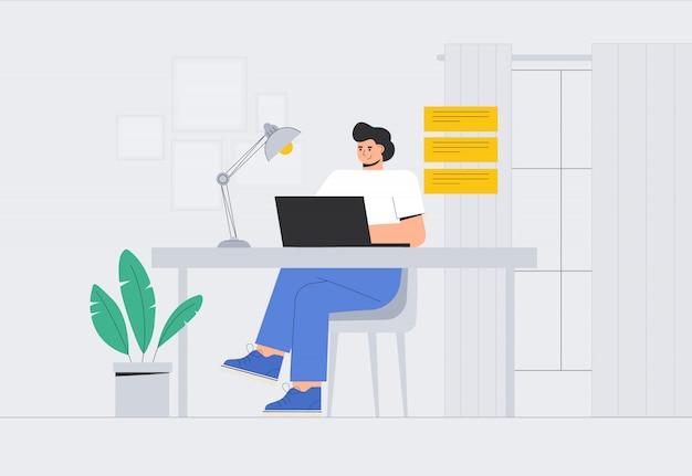 Joven está sentado en una computadora portátil en una habitación acogedora y charlando en las redes sociales