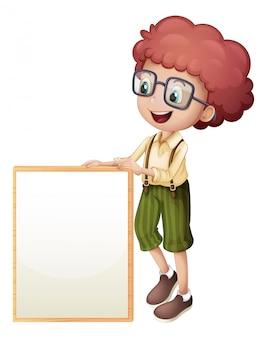 Un joven sosteniendo un marco vacío