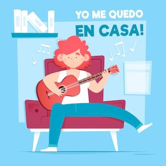 Joven tocando la guitarra en casa