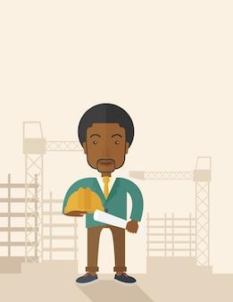Joven trabajador de la construcción africana con casco y blueprint.