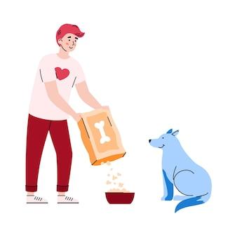 Joven voluntario alimenta a un perro callejero hambriento con una ilustración de comida seca