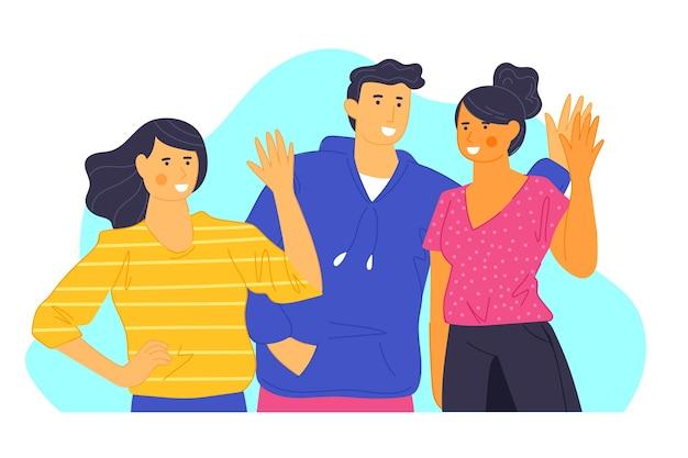 Jóvenes agitando la mano juntos