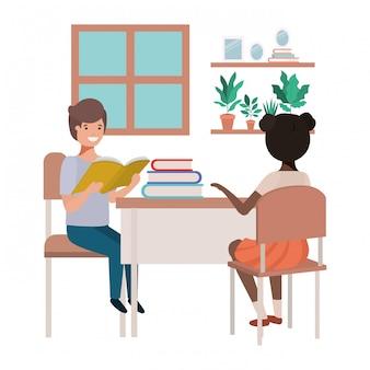 Jóvenes estudiantes sentados en el escritorio de la escuela