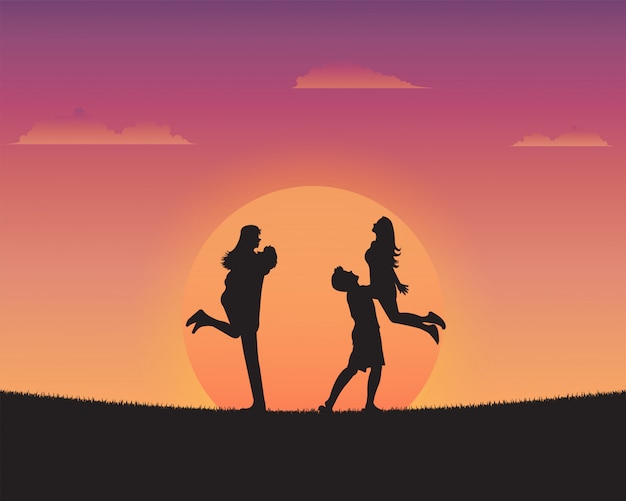 Jóvenes felices silueta de fondo puesta del sol