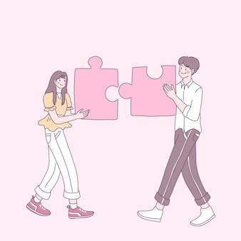Jóvenes que construyen rompecabezas para cumplir su amor.