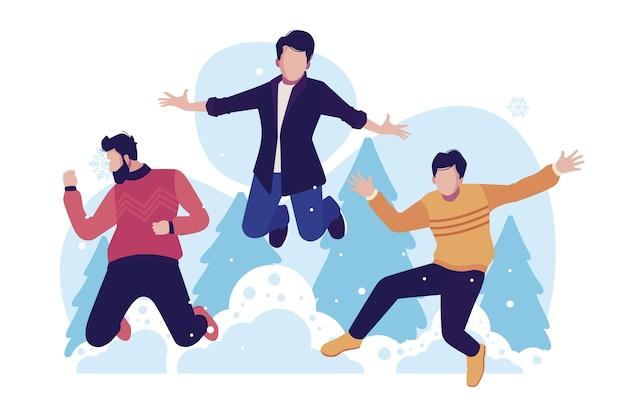 Jóvenes con ropa de invierno saltando con árboles en segundo plano.