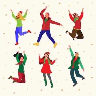 Jóvenes con ropa de invierno saltando
