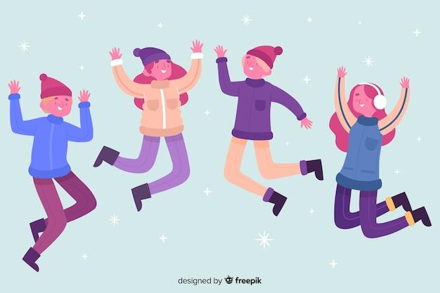 Jóvenes saltando mientras usan ropa de invierno ilustrada