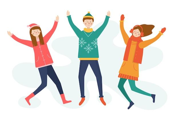 Jóvenes vistiendo ropa de invierno saltando fondo de temporada de invierno