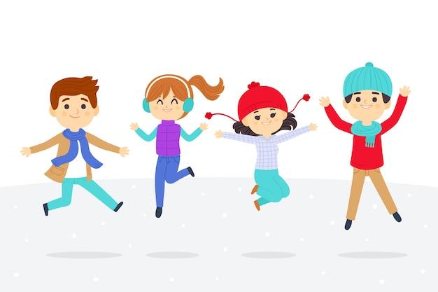 Jóvenes vistiendo ropa de invierno saltando set