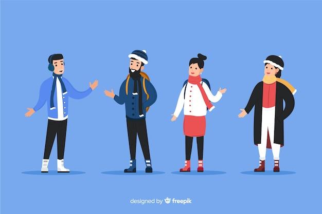 Jóvenes vistiendo ropa de invierno sobre fondo azul.
