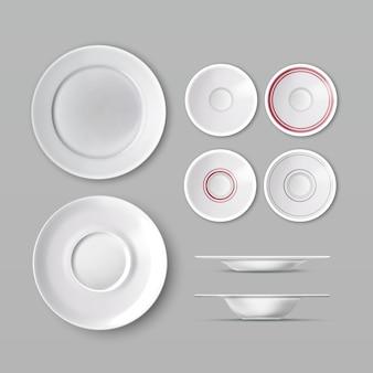 Juego de vajilla con platos vacíos blancos