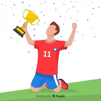 Jugador de fútbol feliz ganando trofeo