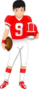 Jugador de fútbol americano posando y sosteniendo el casco y la pelota