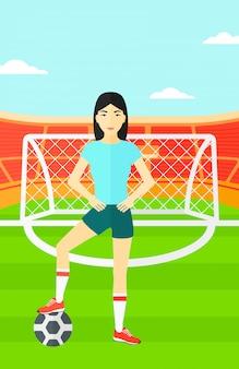 Jugador de fútbol con pelota